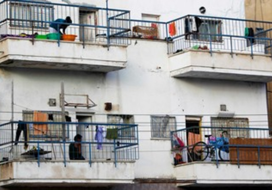 African migrants stand on their balconies at an apartment block in south Tel Aviv.