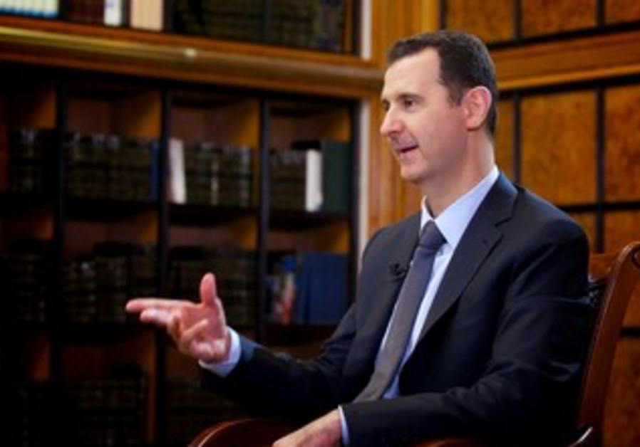Syria's President Bashar Assad speaks during an interview September 12, 2013.