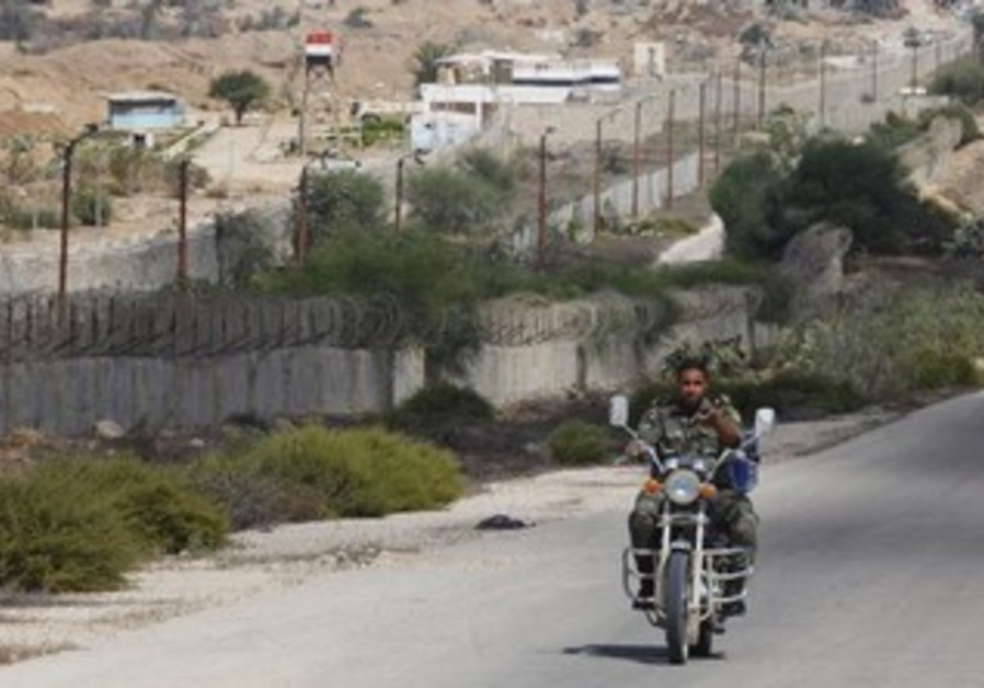A member of Hamas security forces rides a motorcycle on the border between Egypt and southern Gaza.