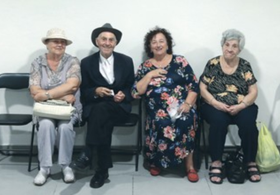 HOLOCAUST SURVIVORS living in Jerusalem gather Monday to celebrate Succot in their bomb shelter.