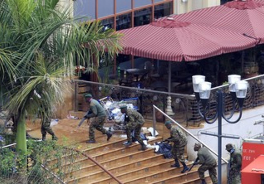 Kenyan soldiers take position at Westgate shopping center on fourth day since militants stormed mall