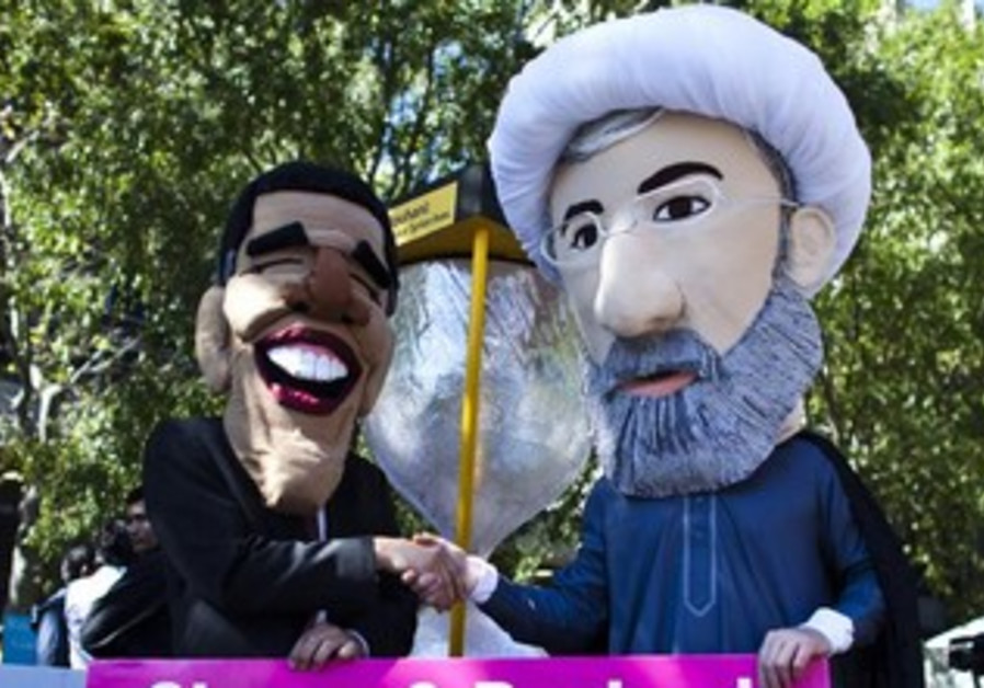 Protesters against an Iran-US thaw carry Obama and Rouhani puppets in New York, Sept. 24, 2013.