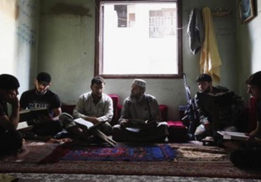Free Syrian Army members take Islam lessons in Aleppo's Saif al-Dawla district, September 18, 2013.
