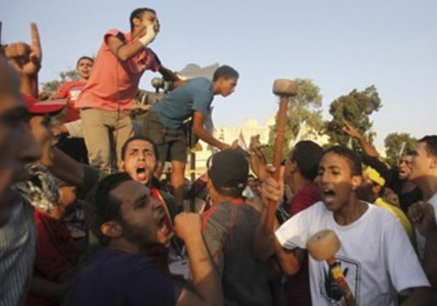 Brotherhood supporters protest outside  El-Thadiya presidential palace in Cairo September 20, 2013.