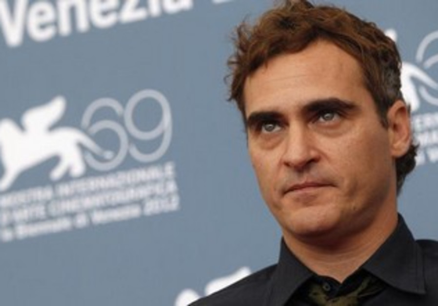 US actor Joaquin Phoenix poses during a photocall for The Master
