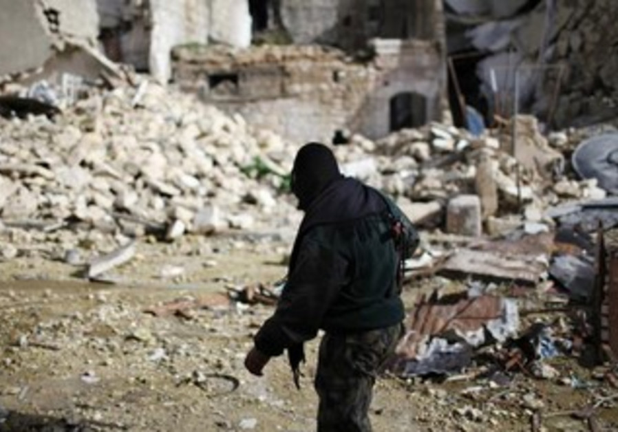 A fighter from Islamist Syrian rebel group Jabhat al-Nusra in Aleppo.
