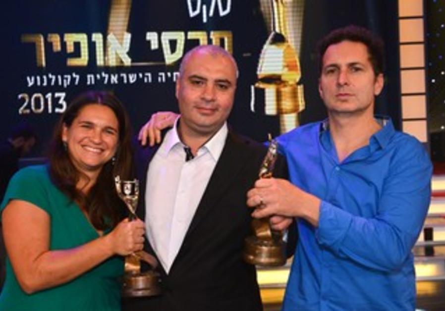 Yuval Adler(R), director of Bethlehem takes home Best Picture award