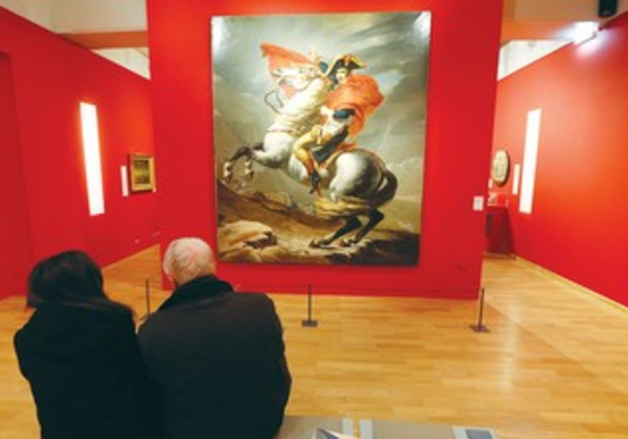 VISITORS LOOK at a painting of Napoleon at the Musee de l'Armee in Paris.