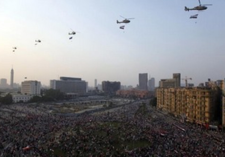 Egyptian army helicopters fly over Tahrir Square in Cairo to celebrate anniversary of Yom Kippur War