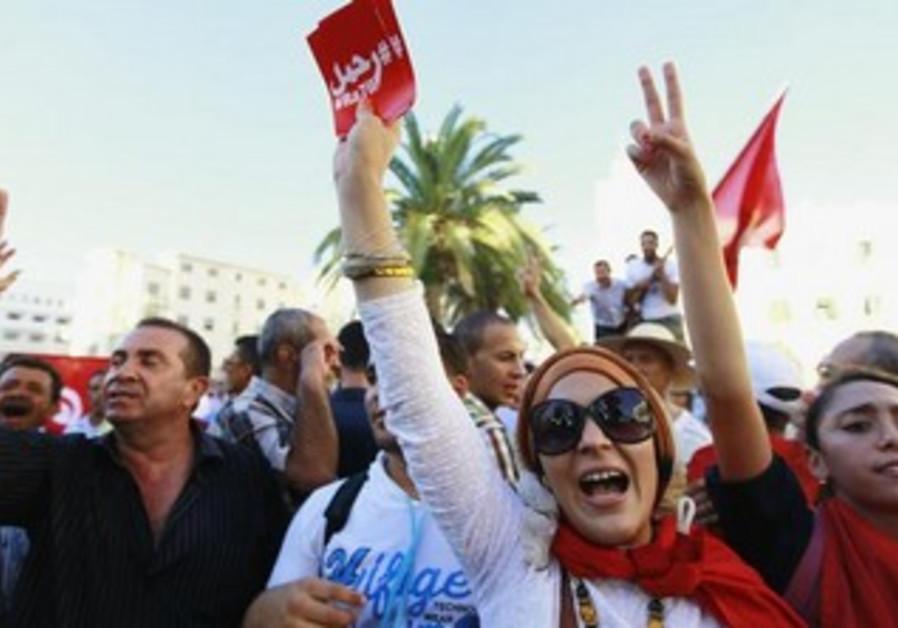 Anti-government protesters rally in Tunisia.
