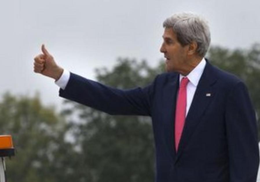John Kerry gives thumbs up