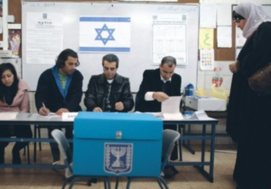 An Israeli-Arab woman votes in Maghar during national elections.