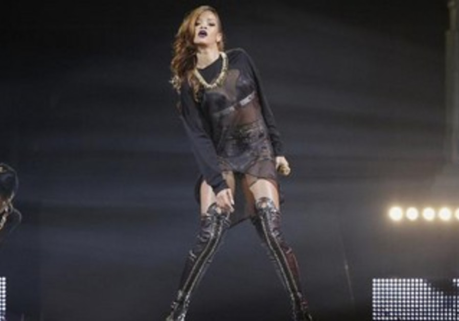 Singer Rihanna performs at the Staples Center in Los Angeles, California April 8, 2013
