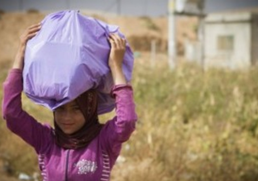 A Syrian refugee in a small refugee camp