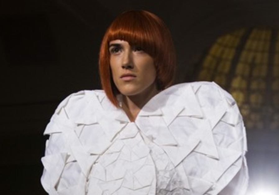 Model presents threeASFOUR Spring/Summer collection piece during New York Fashion Week September 8