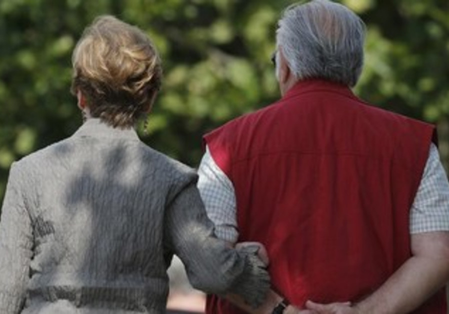 Elderly couple strolling [illustrative].