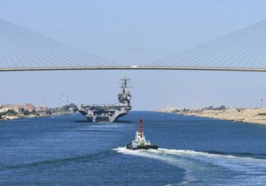 A US aircraft carrier in transit on the Suez Canal.