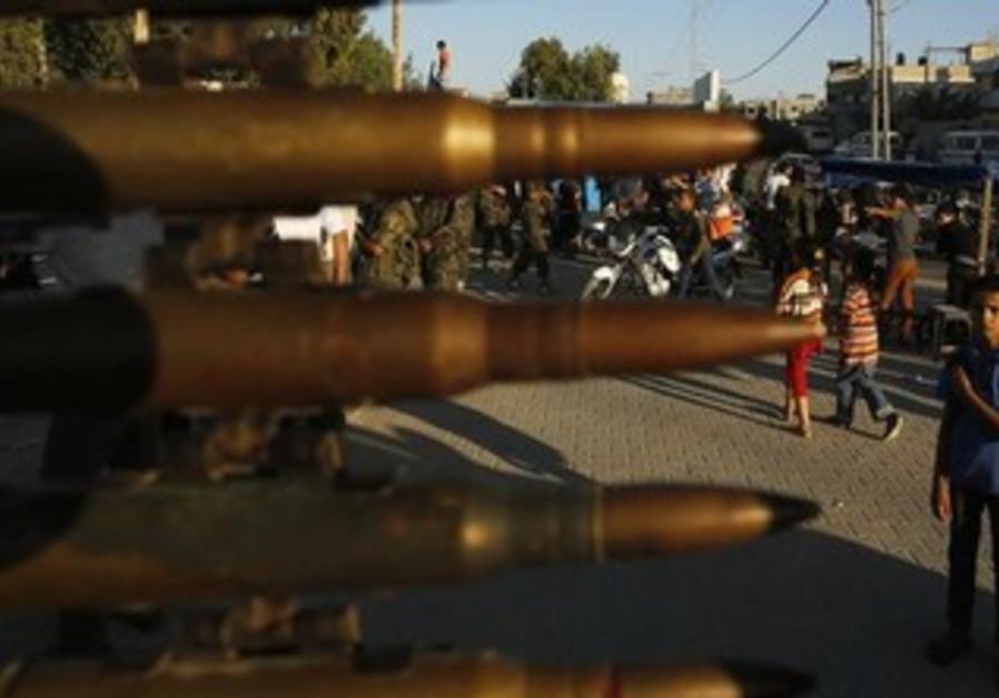 A Palestinian boy looks on during an Islamic Jihad rally