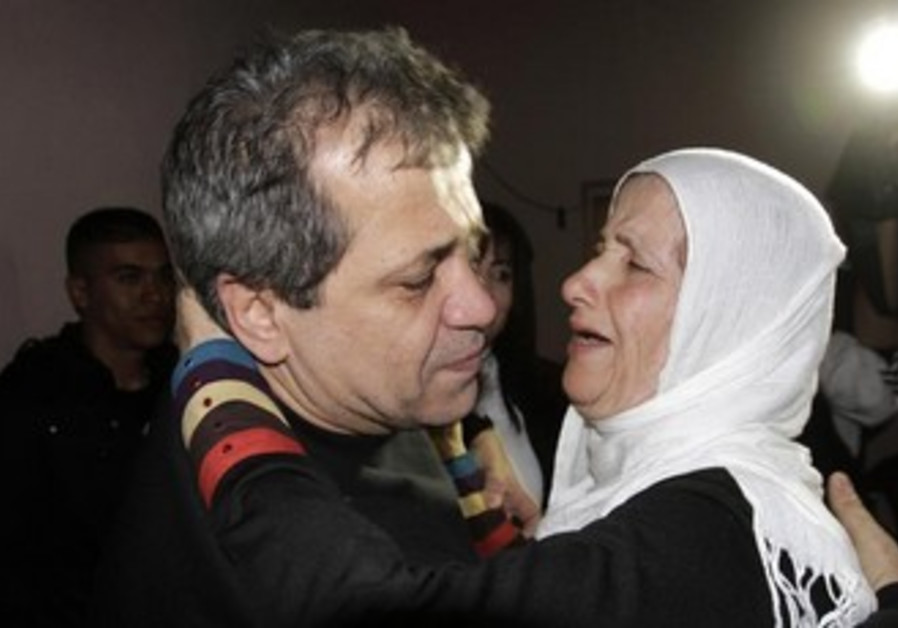 Moayyad Hajji hugs his sister after his release from prison