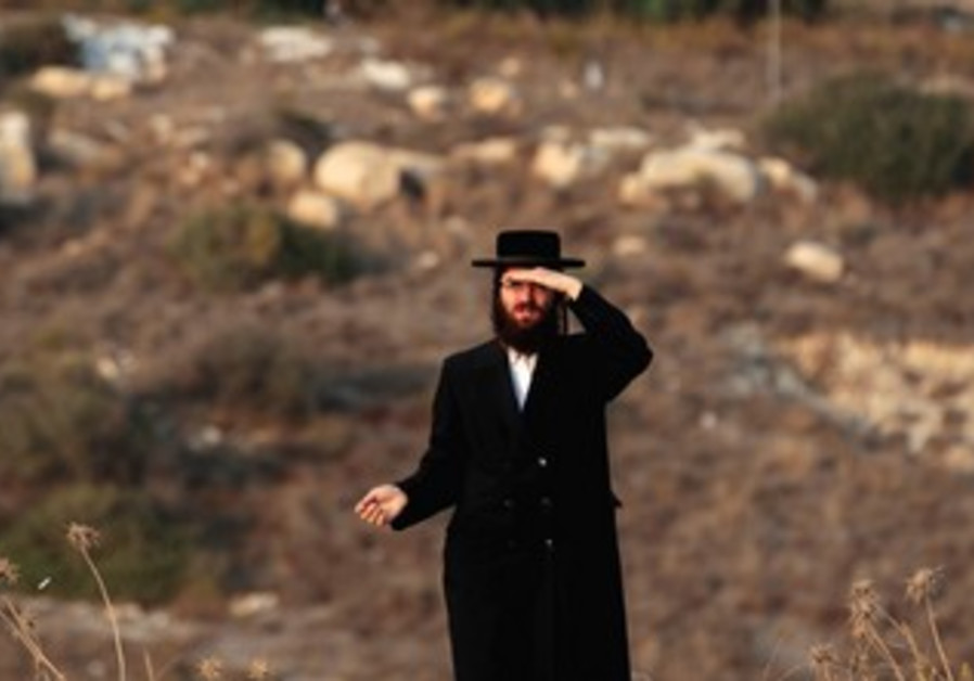 A haredi man stands on a hilltop in Beit Shemesh