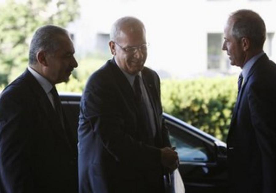 Palestinian negotiators Mohammad Shtayyeh and Saeb Erekat arrive at start of talks in Washington.