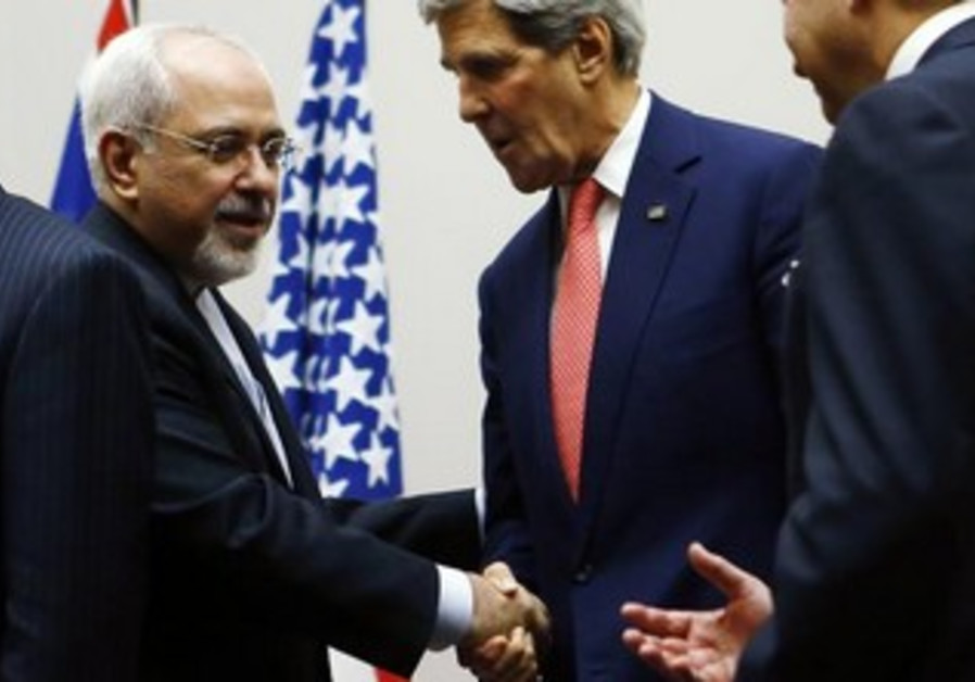 John Kerry shakes hands with Iranian Foreign Minister