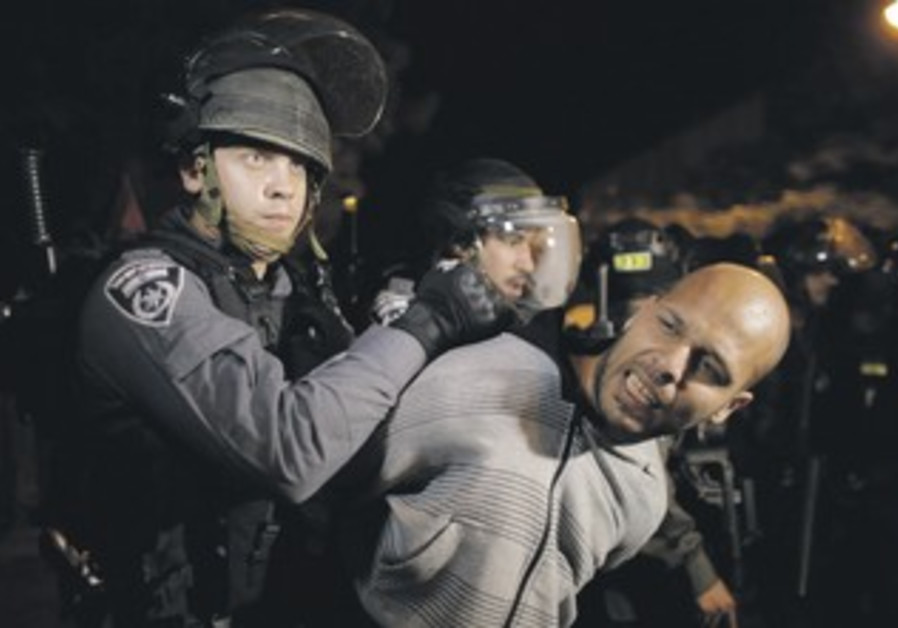 Police detain a protester during a protest in Haifa showing solidarity with Beduin on Saturday.
