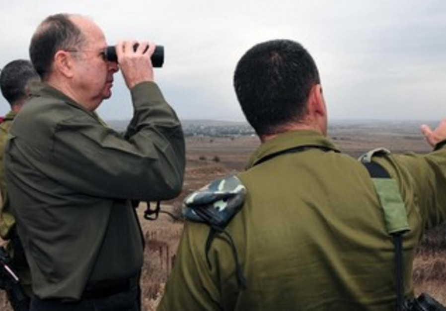 Defense Minister Moshe Yaalon at Syrian Israel border