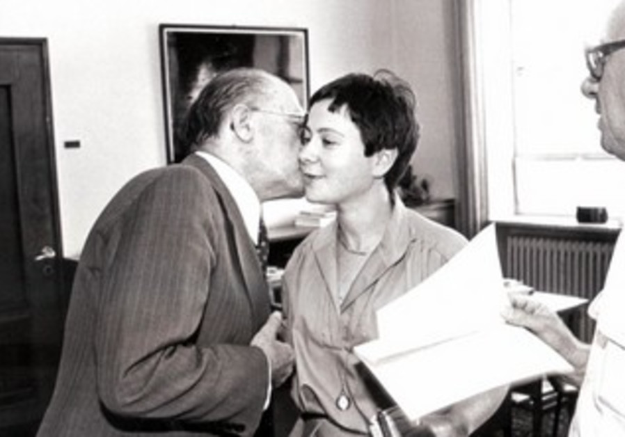 Sarah Honig gets a kiss from Prime Minister Menachem Begin on June 11, 1981