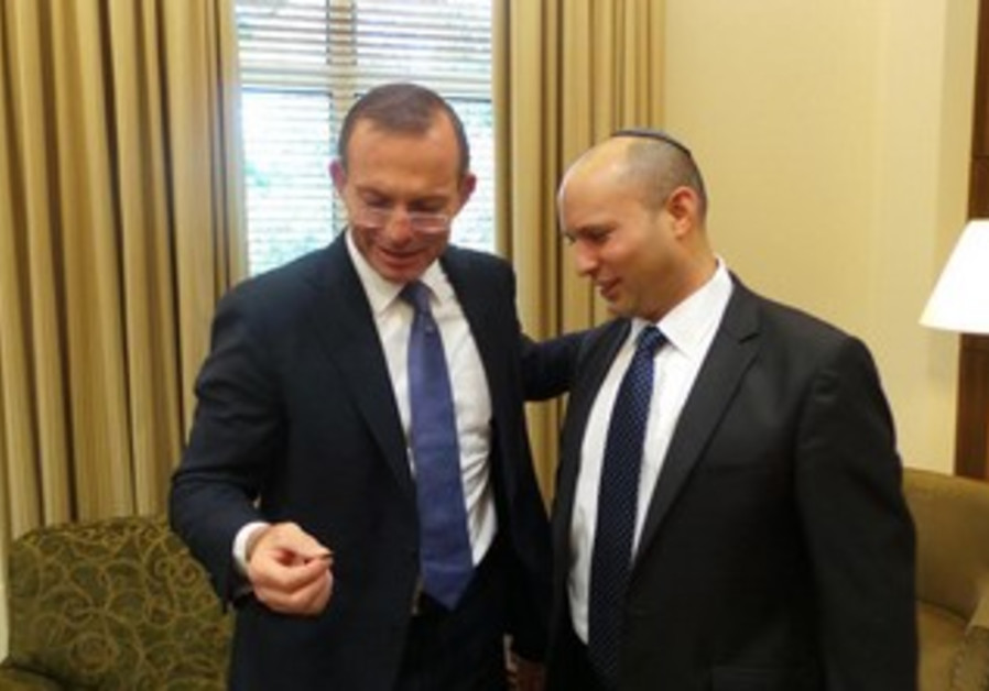 Economy Minister Bennett shows Australian PM 2,000 year old coin from Jerusalem, Dec. 7, 2013