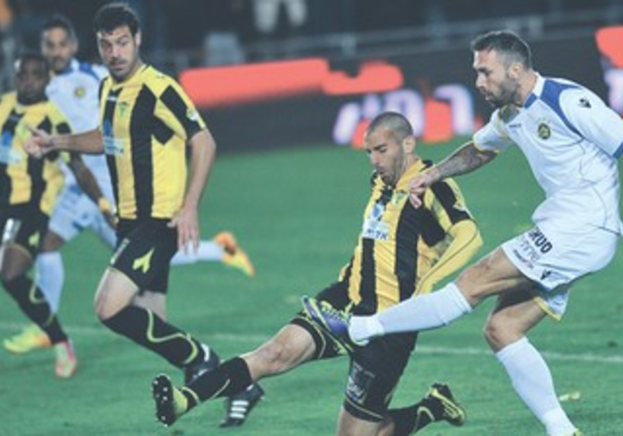 Maccabi Tel Aviv striker Rade Prica (right) scores his team's opener in its 2-1 victory over Beitar