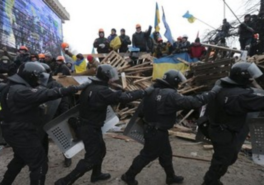 Pro-European integration protesters on barricades in Kiev December 11, 2013.