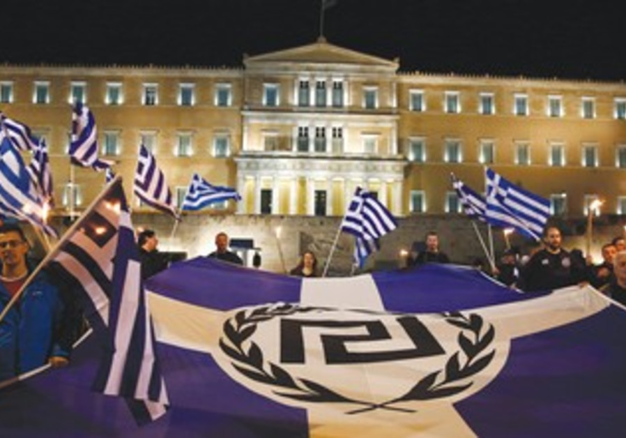 SUPPORTERS OF GREECE'S far-Right Golden Dawn party protest in Athens