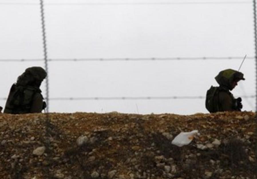 IDF soldiers patrol near the Israel-Lebanon border.