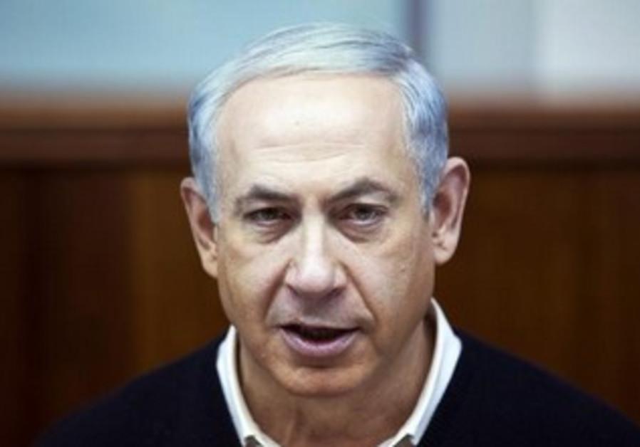Prime Minister Binaymin Netanyahu attends the weekly cabinet meeting in Jerusalem December 15, 2013.