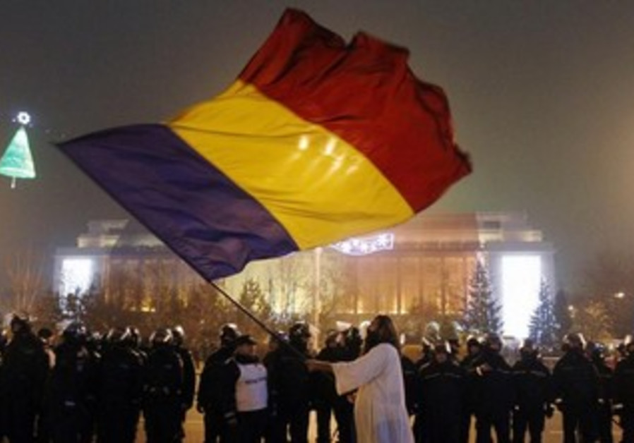 Man waves Romanian flag during protest [file]