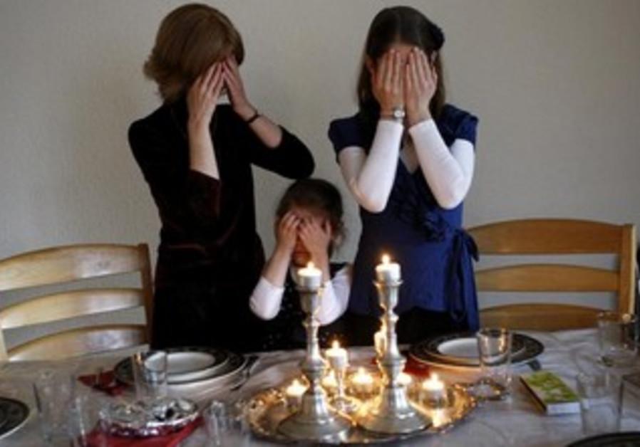 Jewish women welcoming the Sabbath. [File]