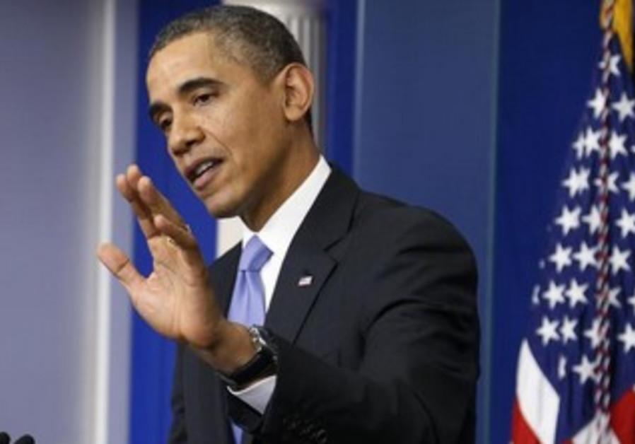 US President Barack Obama gestures during news conference