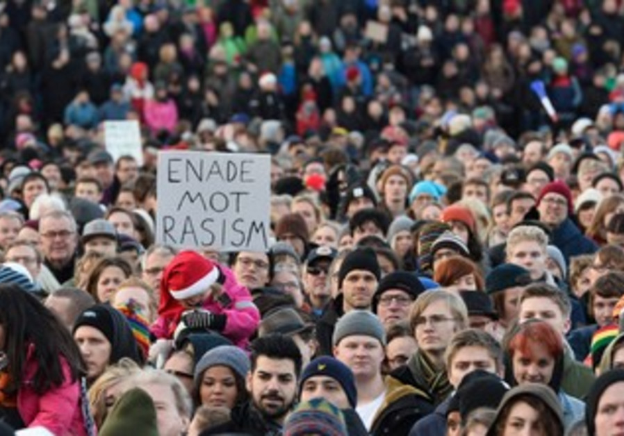 Thousands protest racism in Karrtorp, Sweden on Sunday.