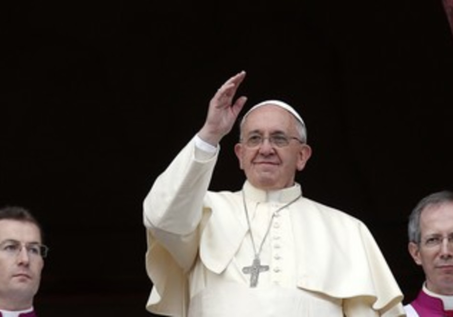 "Pope Francis waves as he delivers his first ""Urbi et Orbi"""