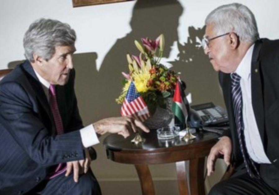 US Secretary of State John Kerry meets with PA President Mahmoud Abbas in Ramallah, January 4, 2014.