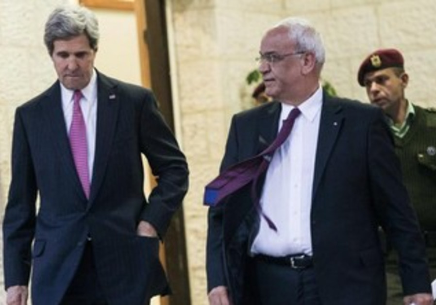 US Secretary of State John Kerry and chief PLO negotiator Saeb Erekat speaking to reporters in Ramal