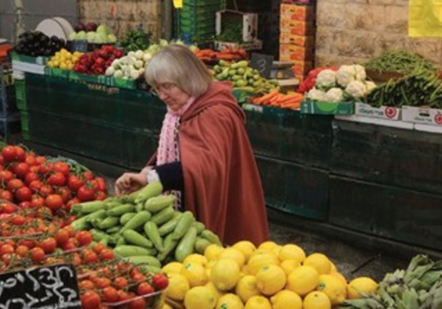 A shopper in Jerusalem's Mahane Yehuda market