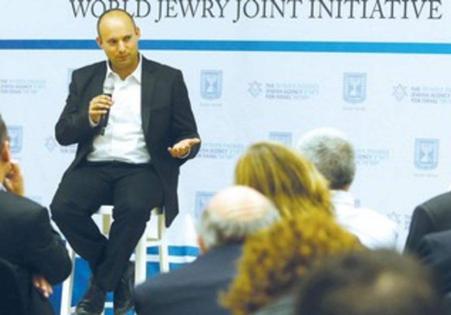 Naftali Bennett speaks to a forum on planning issue.