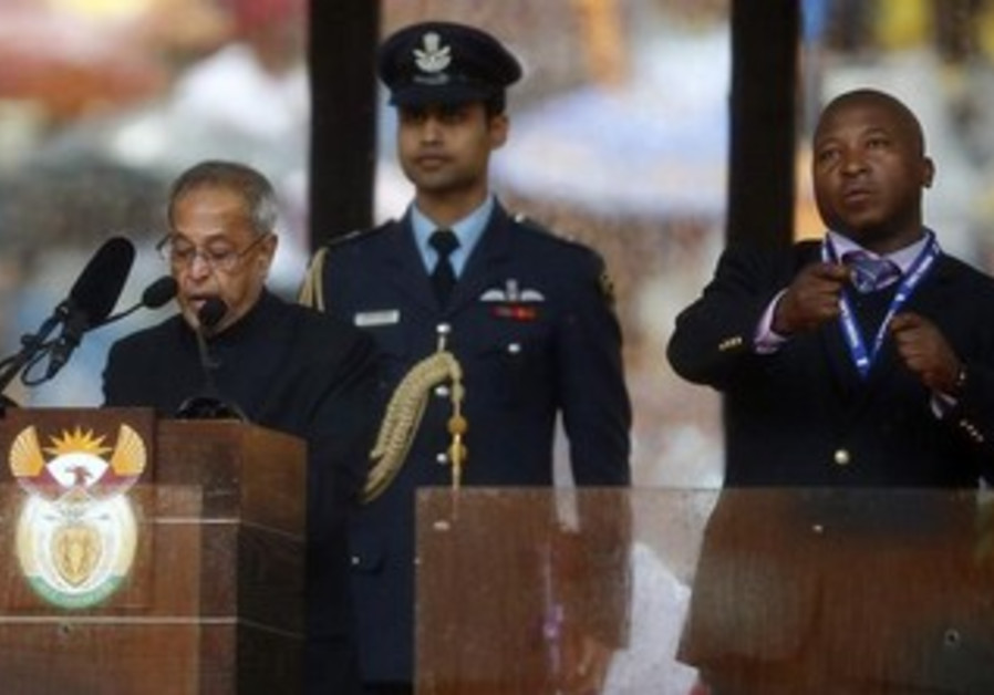 Sign language interpreter at Nelson Mandela's funeral.