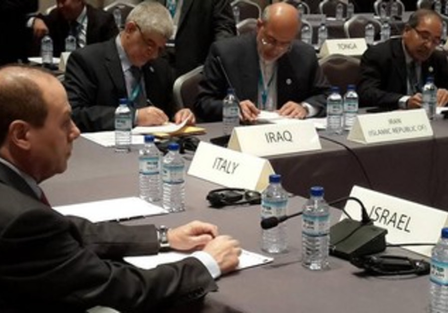 Energy Minister Silvan Shalom at the IRENA assembly with Iranian Energy Minister Hamid Chitchiyan