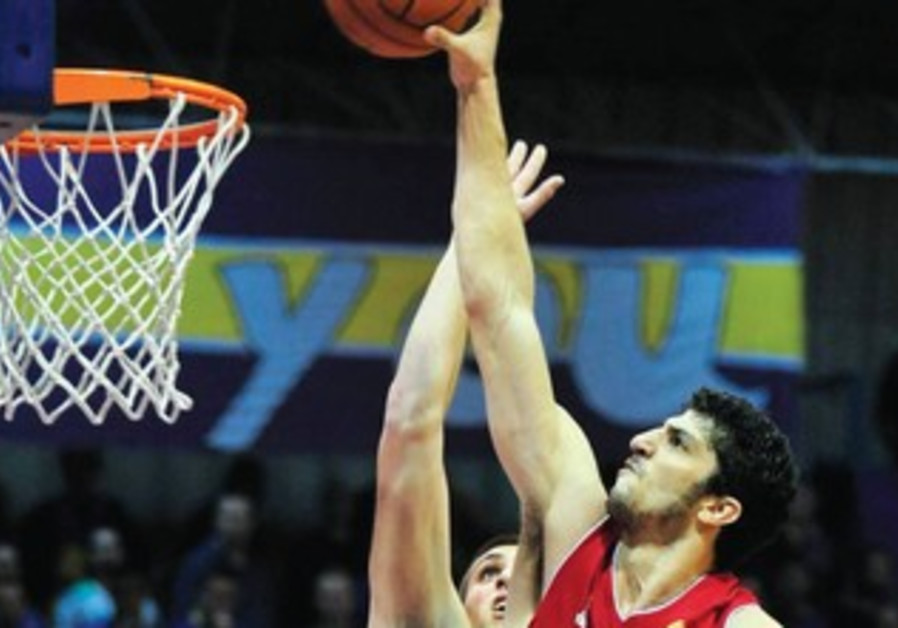 Hapoel Jerusalem forward Lior Eliyahu goes up for two points