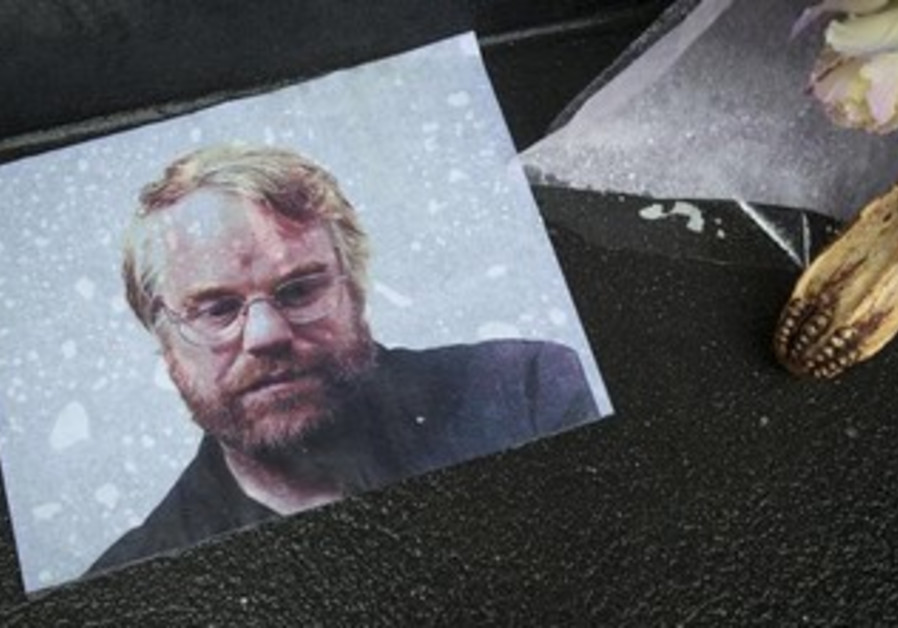 A photo of actor Philip Seymour Hoffman is pictured as part of a makeshift memorial.