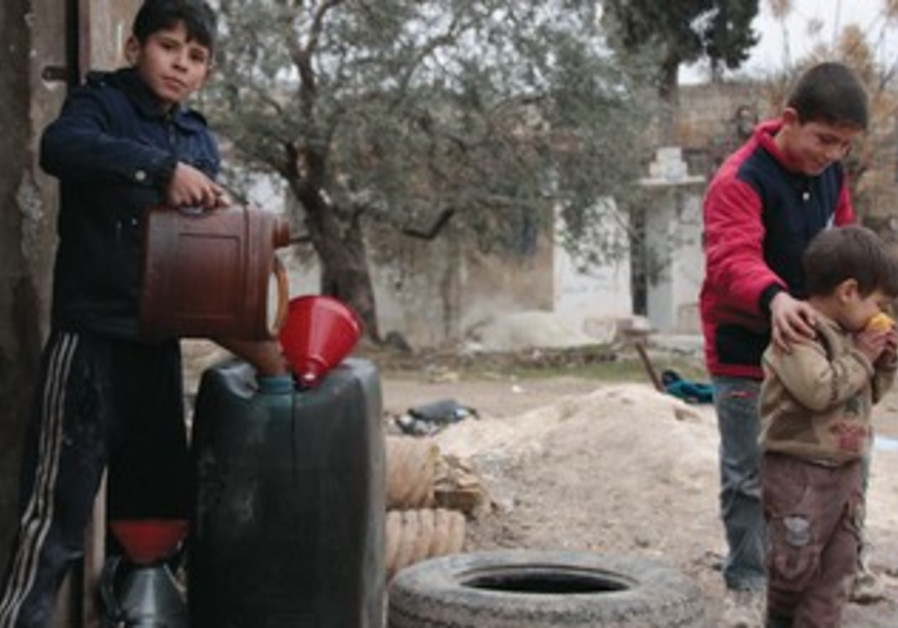 A child vendor sells fuel in Idlib.