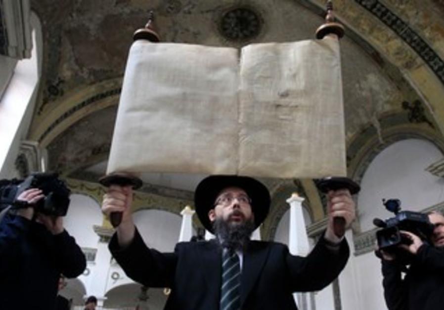 Rabbi Baruch Oberlander with Torah, February 18, 2014.